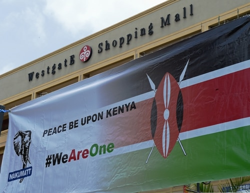 A banner is seen during a memorial ceremony marking the first anniversary of the Westgate terrorist attack, outside the Westgate mall in Nairobi on September 21, 2014. At least 67 people were killed and scores wounded when a small group of Al-Qaeda affiliated fighters stormed the Westgate mall on September 21 2013. AFP PHOTO/Carl de Souza (Photo credit should read CARL DE SOUZA/AFP/Getty Images)