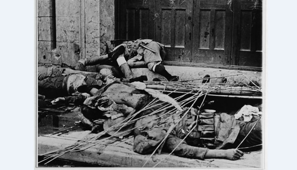 Chinese soldiers, their bodies lying in grotesque heaps, were mowed down by Japanese machine gun fire in the bitter fighting which preceded the capture of Tientsin by Japanese troops, August 1937. Following the 1937 invasion of China, Japanese troops continued to wage war there until Sept. 2, 1945. (U.S. Naval History and Heritage Command)