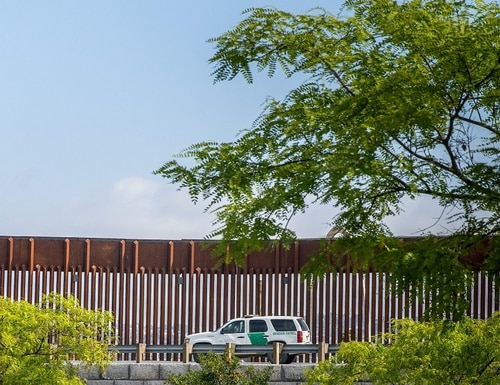 A U.S. Customs and Border patrol car drives past the US/Mexico border fence in San Ysidro, California, on May 31. (Ariana Drehsler/AFP/Getty Images)
