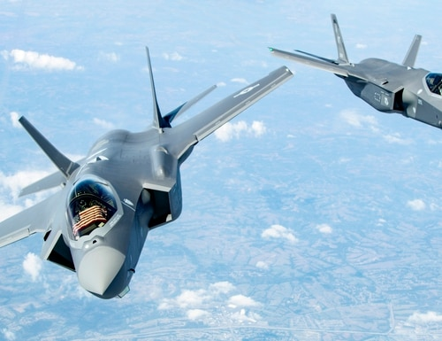 Two F-35s bank after receiving fuel over the Midwest on Sept. 19, 2019. The two aircraft were in route to the 158th Fighter Wing out of the Vermont Air National Guard Base, South Burlington, Vt., the first Air National Guard unit to receive the aircraft. (Master Sgt. Ben Mota/U.S. Air Force)