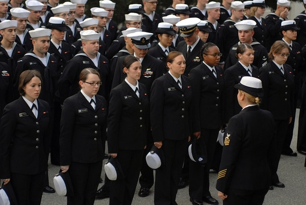 The hairstyles of female sailors are inspected during a personnel inspection at the Presidio of Monterey in California on Nov. 10, 2009. (Navy)