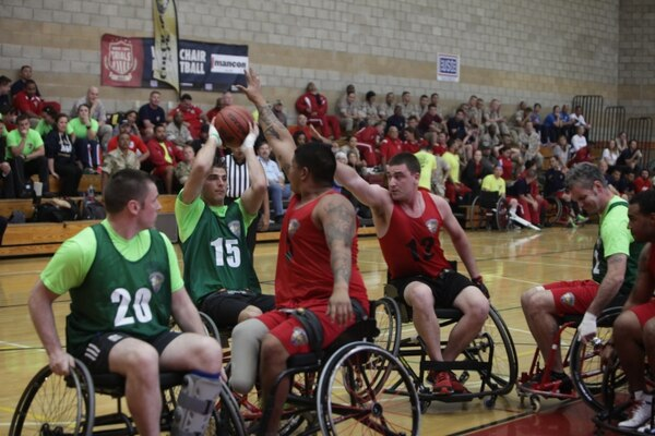 Combat wounded athletes from allied countries and Battalion East go head-to-head during a bronze medal game during the Marine Corps Trials, March 2015. Battalion East barely beat the allies with a final score of 22-18.