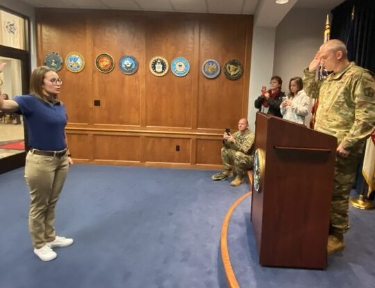 Ana-Alicia Bennett raises her right hand, becoming the first woman to enlist as an 11B in the Virginia Army National Guard. (Sgt. Lisa Sadler/National Guard)