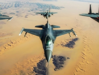 Two Air Force F-16 Fighting Falcons, assigned to the 77th Expeditionary Fighter Squadron, fly in formation with two Royal Saudi Air Force F-15E Strike Eagles during an exercise over Southwest Asia Dec. 15. The Air Force recorded fewer major mishaps in 2020 — but a steep decline in flight hours during the pandemic meant the mishap rate actually ticked up last year. (Staff Sgt. Taylor Harrison/Air Force)