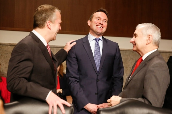 Eric Fanning speaks with Sen. Dan Sullivan (R-AK), left, and ranking member Sen. Jack Reed (D-RI) before his confirmation hearing at the Senate Armed Services Committee to be Secretary of the Army on Thursday, January 21, 2016. (Mike Morones/Staff)
