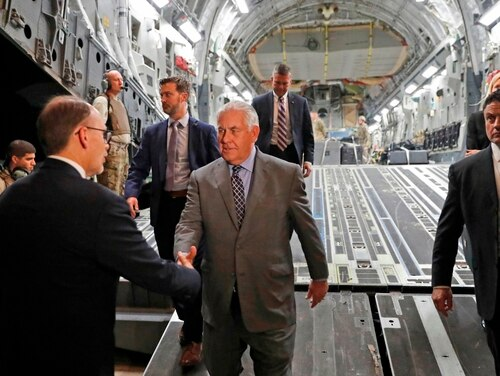 U.S. Secretary of State Rex Tillerson, center, is greeted as he disembarks a plane at Baghdad International Airport on Oct. 23, 2017. (Alex Brandon/AFP via Getty Images)