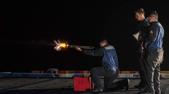 Boatswain's Mate 2nd Class Nikolas Rojas fires an M-500 shotgun Jan. 1, 2019, during a live-fire qualification course aboard Wasp-class amphibious assault ship USS Essex (LHD 2) while on a deployment of the Essex Amphibious Ready Group (ARG) and 13th Marine Expeditionary Unit (MEU). (MC3 Matthew Freeman/Navy)