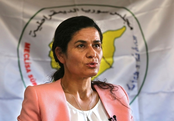 In this July 25, 2017, file photo, Ilham Ahmed, the co-president of the Syrian Democratic Council, the political wing of the Kurdish-led forces backed by the U.S. in Raqqa, gives an interview to The Associated Press, in Kobani, north Syria. (Hussein Malla/AP)