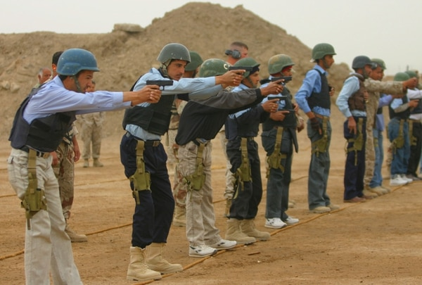 Iraqi police recruits learn to fire small arms with the instruction of Iraqi army personnel and Marines from Multi National Forces-West Training Center (MNF-W TC). MNF-W TC is deployed with Multi National Forces-West in support of Operation Iraqi Freedom in the Al Anbar province of Iraq to develop Iraqi security forces, facilitate the development of official rule of law through democratic reforms, and continue the development of a market based economy centered on Iraqi reconstruction.