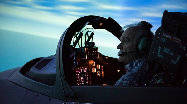 Secretary of the Navy Richard V. Spencer flies a T-45 flight simulator aboard Naval Air Station Kingsville during a Jan. 10 site visit. All naval flight training falls under the Chief of Naval Air Training, which is headquartered in Corpus Christi. ( Anne Owens/Navy)