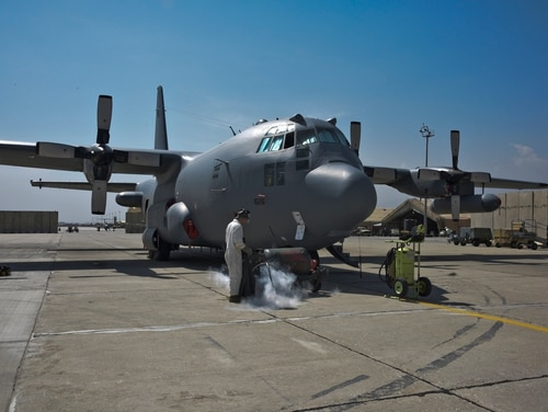 An airman from the 455th Expeditionary Maintenance Group conduct routine maintenance on an EC-130H Compass Call on Bagram Airfield, Afghanistan, Sept. 30, 2018. The modified aircraft uses noise jamming to prevent communication or degrade the transfer of information essential to command and control of weapon systems and other resources. (Staff Sgt. Kristin High/U.S. Air Force)