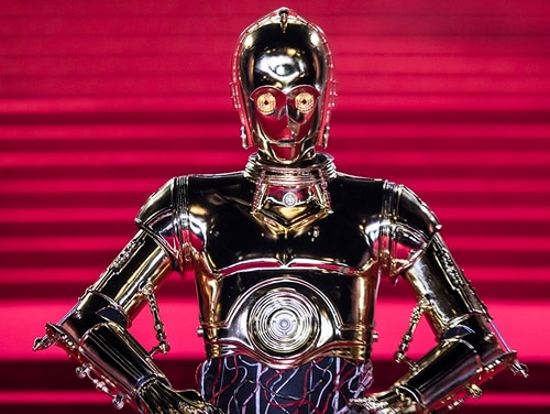 C-3PO (the android, not the Pentagon cloud computing office) poses for photographers ahead of the premiere of the film 'Star Wars: The Last Jedi' in London, Tuesday, Dec. 12, 2017. (Vianney Le Caer/Invision/AP)