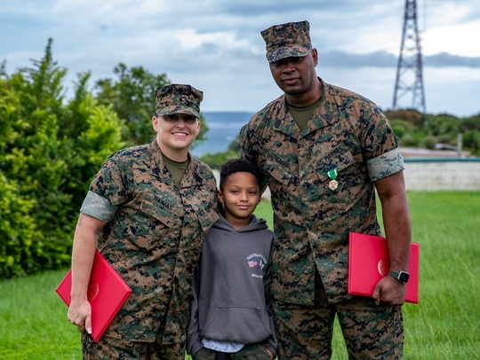 Master Gunnery Sgt. Ronald Thomas and Master Sgt. Sara Thomas receive Navy and Marine Corps Commendation Medals at Camp Courtney, Okinawa, Japan, on June 15, 2021, for their heroic actions at Ta-Taki Falls on Sept. 13, 2020. (Lance Cpl. Natalie Greenwood/Marine Corps)