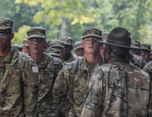 New soldiers arriving for their first day of basic combat training at Fort Jackson, South Carolina, are