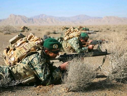 Iranian soldiers participate in an infantry drill in Isfahan province on Friday. Iranian officials continue to detain a U.S. Navy veteran. (Iranian Army via AP)