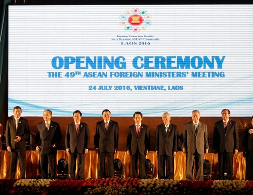 Laotian Prime Minister Thongloun Sisoulith, sixth from left, and Laotian Foreign Minister Saleumxay Kommasith, sixth from right, stand with with Southeast Asian foreign ministers, from left, an unidentified delegate from Malaysia, Aung San Suu Kyi of Myanmar, Vivian Balakrishnan of Singapore, Don Pramudwinai of Thailand, Pham Binh Minh of Vietnam, Thongloun Sisoulith, Saleumxay Kommasith, Perfecto Yasay Jr. of the Philippines, Brunei's Trade Minister Jock Seng Pehin Lim, Sakhonn Prak of Cambodia, Retno Marsudi of Indonesia and ASEAN Secretary General Le Luong Minh, as they pose for a group photo during the opening ceremony of the 49th Association of Southeast Asian Nations (ASEAN) Foreign Ministers' Meeting in Vientiane, Laos, Sunday, July 24, 2016. (AP Photo/Sakchai Lalit)
