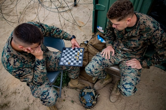 Two Marine intelligence analysts play a game of chess while on a break during an exercise on Marine Corps Base Camp Pendleton, California, May 13, 2021. (Sgt. Marvin E. Lopez Navarro/Marine Corps)