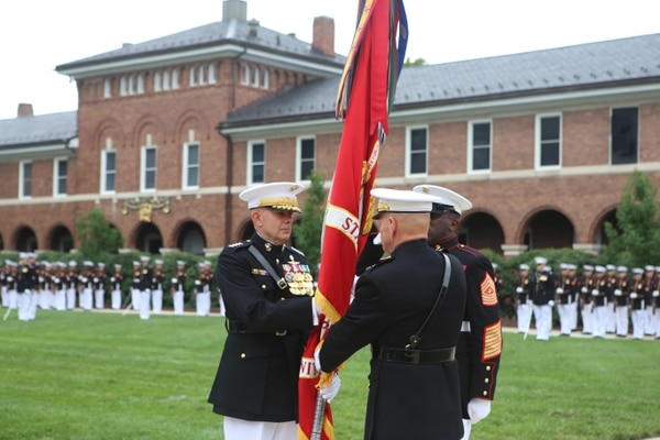 Gen. David Berger, left, and 37th Commandant of the Marine Corps Gen. Robert Neller in a passage of command ceremony Thursday at the Washington, D.C., barracks. (Andrea Scott/Staff)