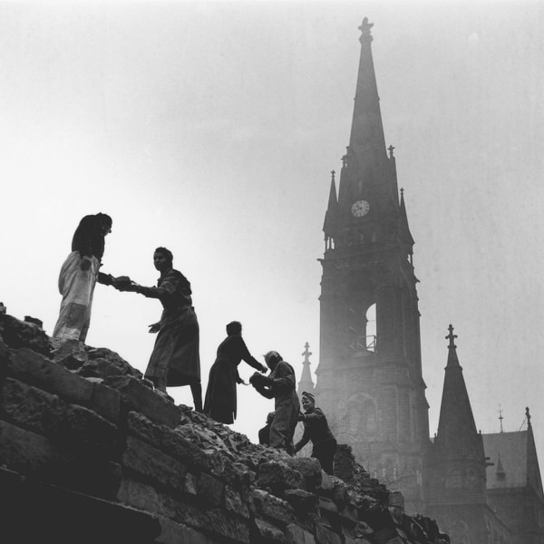 Women form a human chain to carry bricks used in the reconstruction of Dresden in March 1946 after allied bombing destroyed the city in February 1945. The steeple of the wrecked Roman Catholic cathedral can be seen in the background. (Fred Ramage/Keystone Features/Hulton Archive/Getty Images)