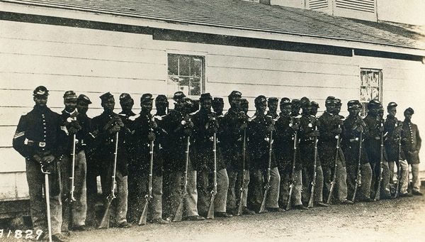 Members of the U.S. Colored Infantry in 1862 line up at Fort Lincoln, Washington, D.C. (National Archives)