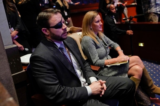 Rep.-elect Dan Crenshaw, R-Texas, left, listens during member-elect orientations on Capitol Hill in Washington. Crenshaw is among 19 new veterans elected to Congress this year. (Pablo Martinez Monsivais/AP)