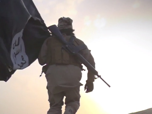 ISIS' latest propaganda video features an ISIS fighter with a slung U.S. M-16 rifle and ISIS flag.