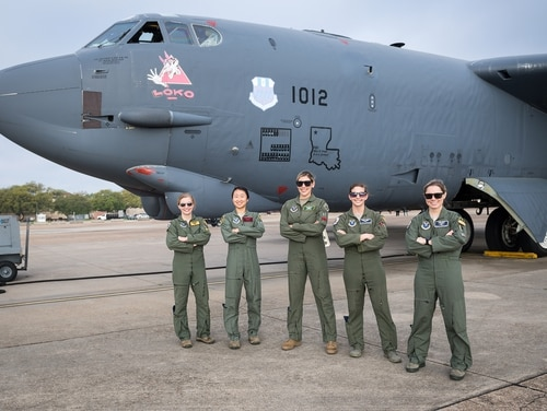 Aircrew members pose for a picture at Barksdale Air Force Base, La., March 26, 2020. An all-woman aircrew from the 96th BS, 11th Bomb Squadron, 20th Bomb Squadron and the 2nd Bomb Wing flew for Women's History Month. (Senior Airman Lillian Miller/Air Force)