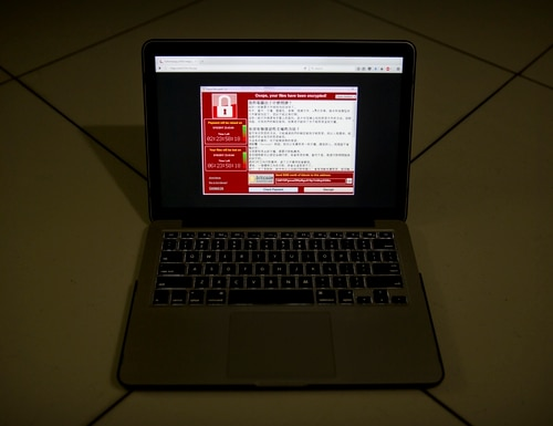 A screenshot of the warning screen from a purported ransomware attack, as captured by a computer user in Taiwan. (Mark Schiefelbein/AP)