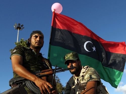 Libyan troops sit on an armored personnel carrier during a demonstration calling on the international community to arm the Libyan army in August 2015. Congressional committee members want to know what the Trump administration plans to do as ISIS and al-Qaida persist there and evidence shows Russia is pushing into the years-long civil war. (Abdullah Doma/AFP/Getty Images)