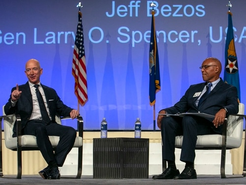 Jeff Bezos, left, founder of aerospace company Blue Origin, gives a Q&A-style keynote during an Air Force Association conference. (Alan Lessig/Staff)