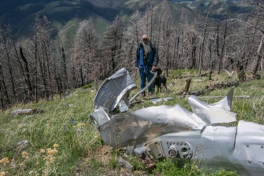 This June 2016 file photo shows wreckage from a U.S. Air Force that bomber crashed on Emigrant Peak in Montana on July 23, 1962, killing four men during a training run. The wreckage still remains on a remote section of the peak. (Adrian Sanchez-Gonzalez/Bozeman Daily Chronicle via AP)