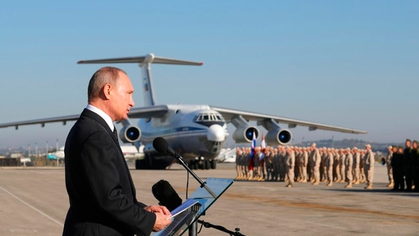 In this file photo taken on Tuesday, Dec. 12, 2017, Russian President Vladimir Putin addresses the troops at the Hemeimeem air base in Syria. Several private Russian military contractors were killed by a U.S. strike in Syria, Russian media reported Tuesday, Feb. 13, 2018 in a development that could further inflame Russia-U.S. tensions if officially confirmed. (Mikhail Klimentyev/Pool Photo via AP)