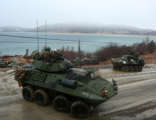 U.S. Marines drive to a checkpoint during Cold Response 14, a multinational exercise in northern Norway. The service wants to replace the LAV-25 with a new advanced reconnaissance vehicle. (Courtesy of the U.S. Marine Corps)