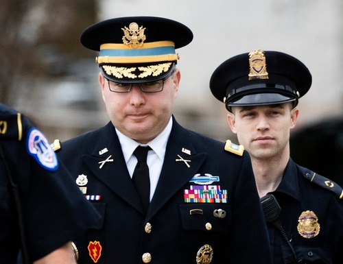 Army Lt. Col. Alexander Vindman, a military officer at the National Security Council, center, arrives on Capitol Hill in Washington on Oct. 29, 2019. (Manuel Balce Ceneta/AP)