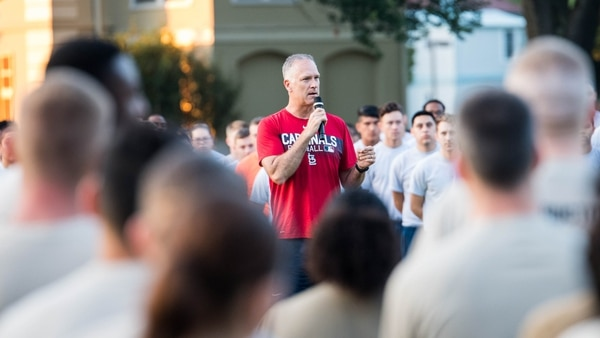 Col. Michael Miller, commander of Barksdale Air Force Base in Louisiana and the 2nd Bomb Wing, gives comments before an Aug. 2 resiliency run for suicide prevention, during which he called suicide