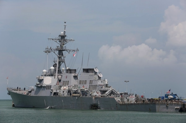 The Guided-missile destroyer USS John S. McCain (DDG 56) is moored pier side at Changi naval base in Singapore following a collision with the merchant vessel Alnic MC Monday, Aug. 21, 2017. The USS John S. McCain was docked at Singapore's naval base with