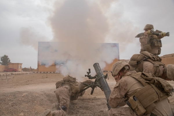 Marines fire a mortar round at known ISIS staging areas in the Middle Euphrates River Valley's Deir Ezzor province, Syria, Oct. 12. (Sgt. Matthew Crane/Army)