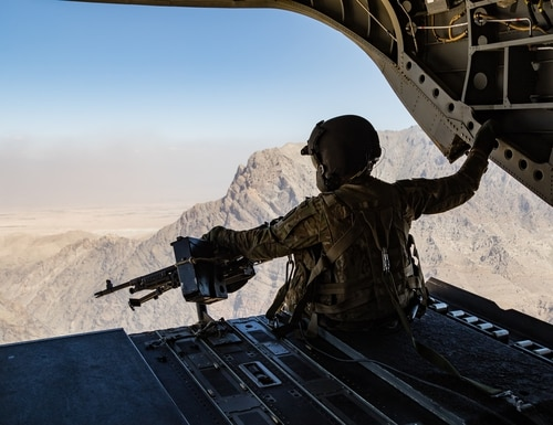 An Army CH-47 Chinook helicopter crew chief scans below during a flight near Jalalabad, Afghanistan, June 12, 2017. (Army)