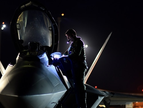 An F-22 Raptor pilot with the 95th Fighter Squadron performs a preflight inspection prior to night flying operations at Tyndall Air Force Base, Fla., June 11. Air Force Secretary Heather Wilson said Tyndall's Raptors, which will be temporarily housed at nearby Eglin after Hurricane Michael, will be back in the air over the Panhandle by Thanksgiving. (Airman 1st Class Isaiah Soliz/Air Force)