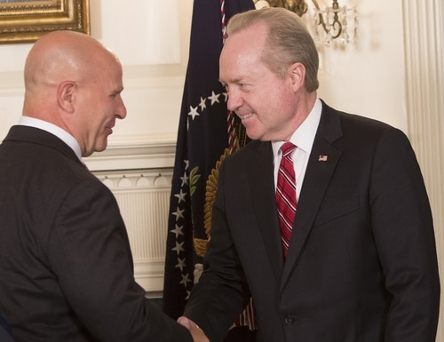 Thomas Kennedy, right, chairman and CEO for Raytheon, shakes hands with national security adviser H.R. McMaster at the signing of a memorandum addressing China's laws, policies, practices and actions related to intellectual property, innovation and technology at the White House on Aug. 14, 2017, in Washington, D.C. (Chris Kleponis/Getty Images)