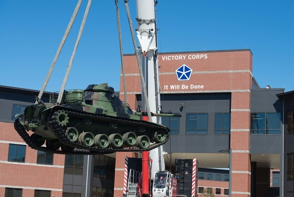 A tanks is lowered to its new home in front of the V Corps headquarters at Fort Knox, Ky., Oct. 14, 2020. (Charles Leffler/V Corps)
