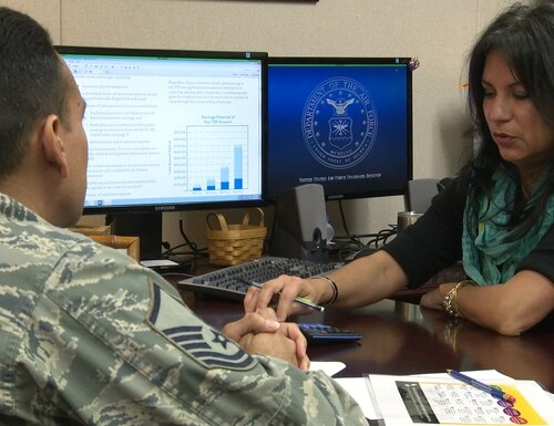 Criselda Smith, Joint Base San Antonio-Randolph military and family readiness consultant, works with a client to explore investment options for the Thrift Savings Plan on Feb. 10, 2016. (Sean Schroeder/U.S. Air Force)