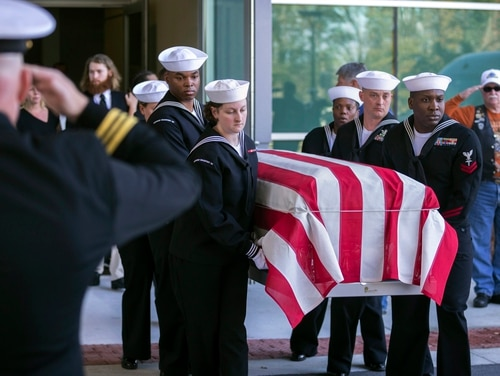 A Navy honor guard carried the casket of 21-year-old Naval Aircrewman Mechanical 3rd Class Cameron Scott Walters after his funeral service in Savannah, Ga., in December. (Stephen B. Morton/Atlanta Journal-Constitution via AP)