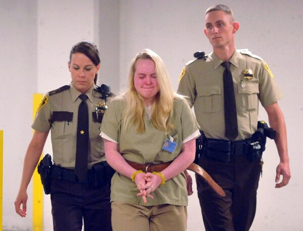 In this photo taken May 14, 2015, Jamie Silvonek, 14, is escorted to court for a preliminary hearing in Allentown, Pa. Silvonek, accused of plotting with her boyfriend 21-year-old Army Spc. Caleb Barnes via text to kill her mother, pleaded guilty Thursday, Feb. 11, 2016, in a deal with prosecutors. As part of the deal, Silvonek pleaded guilty to first-degree murder, criminal conspiracy, abuse of a corpse and tampering with evidence. She will be eligible for parole after serving 35 years. (Bill Adams/The Express-Times via AP) MANDATORY CREDIT
