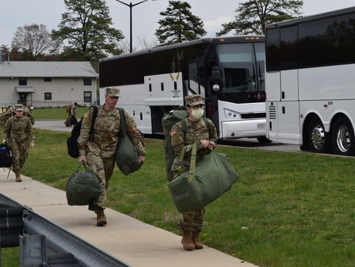 Soldiers with an Urban Augmentation Medical Task Force board a bus at the John E. Smathers Reserve Center at Fort Meade, Maryland, on April 7, 2020. (Army)