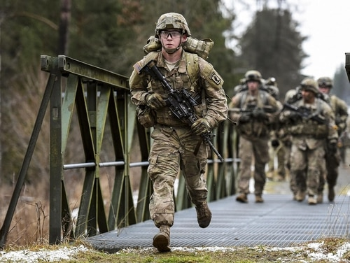 Spc. Shane Rader runs during a 12-mile ruck march as part of testing for the Expert Infantryman Badge at the Grafenwoehr Training Area, Germany, Feb. 5, 2016. (Gertrud Zach/Army)