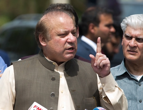 Pakistani Prime Minister Nawaz Sharif speaks to reporters outside the premises of the Joint Investigation Team, in Islamabad, Pakistan, on June 15, 2017. Pakistan's Supreme Court in a unanimous decision has asked the country's anti-corruption body to file corruption charges against Prime Minister Nawaz Sharif, his two sons and daughter for concealing their assets. (B.K. Bangash/AP)