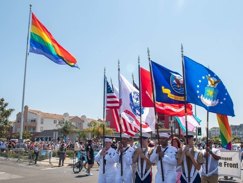 Color Guard members from the Navy and Marine Corps march at the 2018 San Diego Pride Parade. (Mass Communication Specialist 3rd Class Nicholas Burgains/Navy)