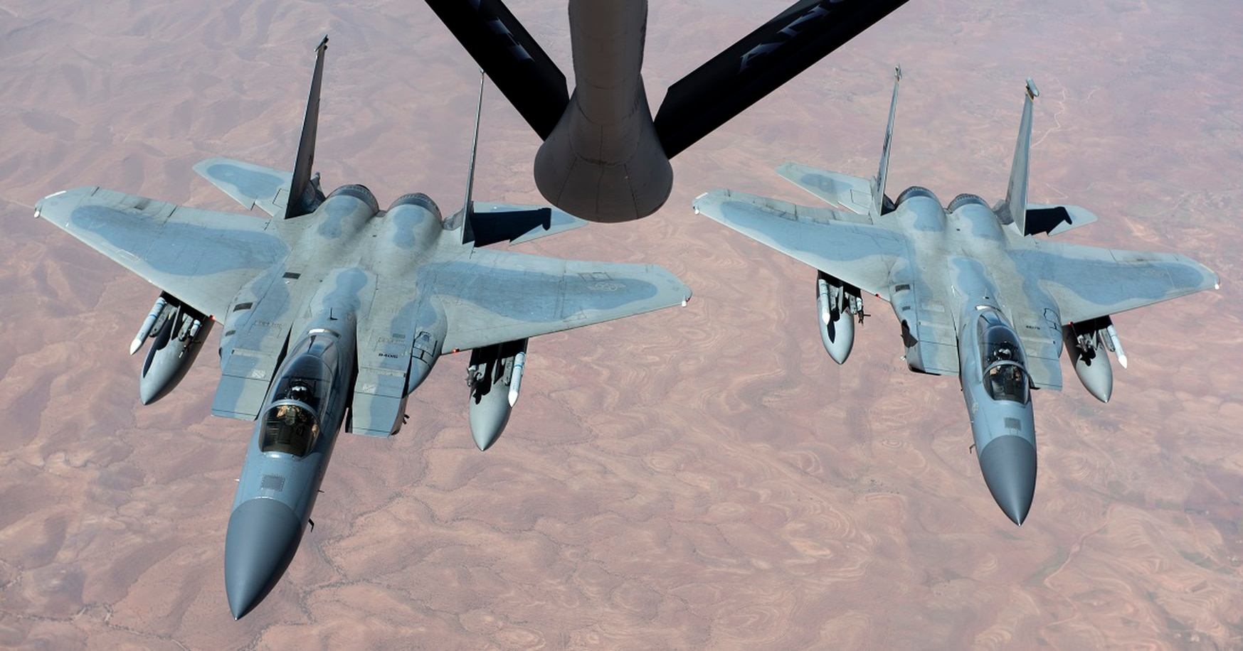 F-15C Eagles receive fuel over Morocco in April 2018. With Nigerien Air Base 201 becoming operational, violent extremists are not going to know what's there and what we're doing, said retired Gen. Hawk Carlisle, former head of Air Combat Command. (Senior Airman Malcolm Mayfield/Air Force)