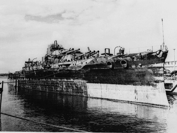 The USS Oklahoma leaves the Pearl Harbor drydock in this Nov. 27, 1944 photo. The ship was sunk at Pearl Harbor and on Wednesday, Nov. 11, 1998, after 57 years, a monument will be dedicated in Oklahoma to those who were killed. (AP Photo)